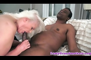 Attracting granny engulfing primarily a grand nefarious dick