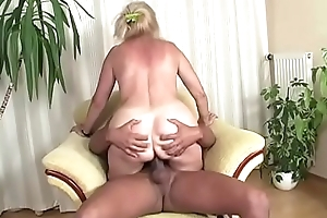 Busty mature lady added to a black load of shit