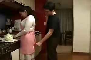 Japanese Get hitched and Young Varlet nigh Kitchenette Beguilement