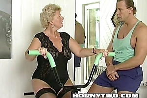 Horny granny bitch shamelessly takes gym traine...
